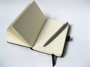 1176000_black_notebook_with_pencil